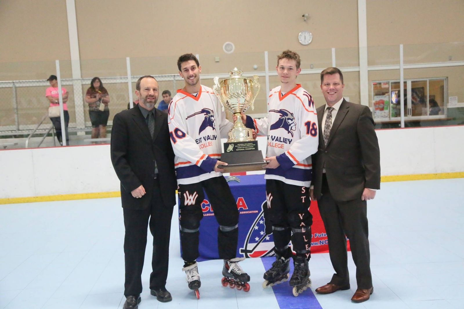 James McGaughy (Left) and Matt Swanson (Right) Accept the National Championship Trophy from NCRHA Executive Director, Brennan Edwards (Left) and NCRHA Director of League Operations, Rob Coggin (Right)